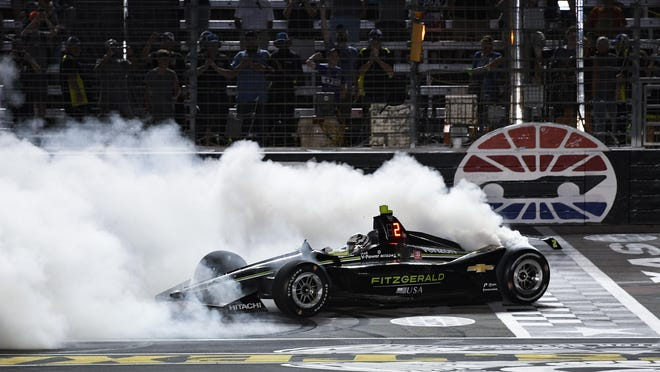 Josef Newgarden does a burnout after winning the IndyCar auto race on June 8, 2019 at Texas Motor Speedway in Fort Worth, Texas. IndyCar opens its pandemic-delayed season with an all-in-one-day show Saturday, June 6, 2020 on the fast high-banked 1½-mile oval at Texas Motor Speedway, more than eight months after the 2019 finale.