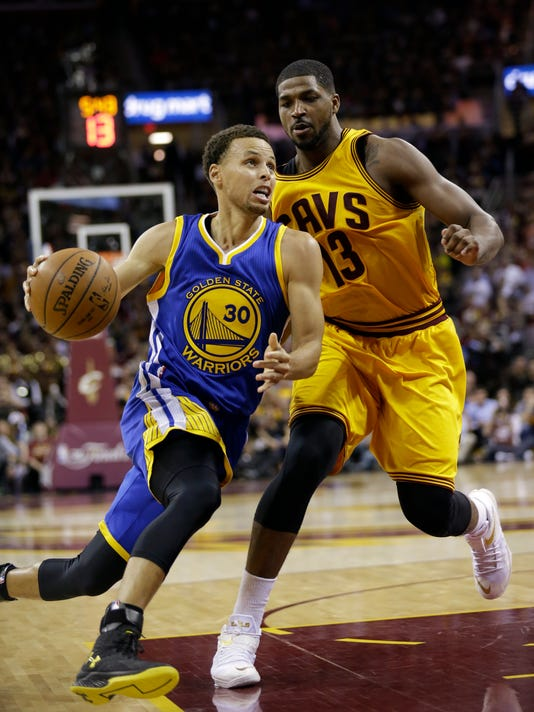 Golden State Warriors guard Stephen Curry (30) drives on Cleveland  Cavaliers center Tristan Thompson 45659f261
