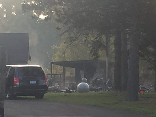 Charred debris and smoke are visible after a fire Sept.