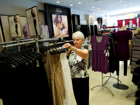 Cape Coral resident Jan Mulligan browses through some of the selections at Soma at the Bell Tower Shops in south Fort Myers<137>on Thursday 6/19/2014<137>. The intimate apparel brand from Fort Myers-based Chico's FAS celebrates its 10th anniversary this month.