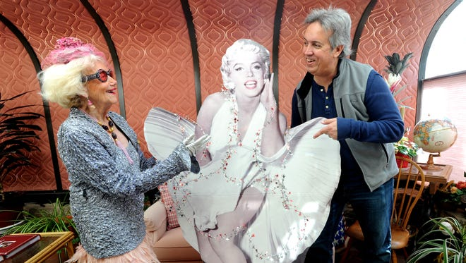 Roy Helen Ackers and Reporter-News photojournalist Ron Erdrich pose with a Marilyn Monroe cutout at Ackers' home.