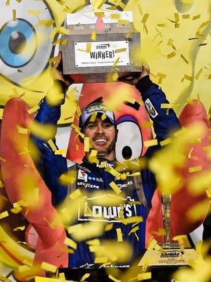 Jimmie Johnson celebrates his third victory of the season, in the SpongeBob SquarePants 400.