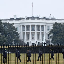 Secret Service officers search the south grounds of the White House after an unmanned aerial drone was found on the White House grounds in January.