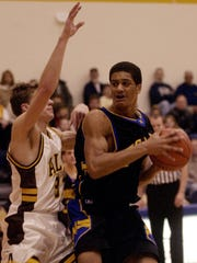 Moeller's Josh Duncan drives to the hoop against Alter's