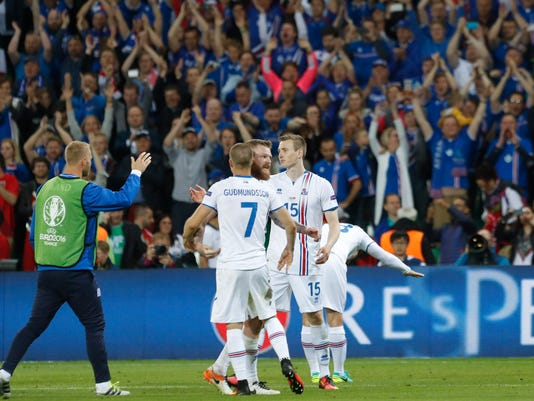 Iceland's players celebrate at the end of the Euro 2016 Group F soccer match between Portugal and Iceland at the Geoffroy Guichard stadium in Saint-Etienne, France, Tuesday, June 14, 2016. The match ended in a 1-1 draw. (AP Photo/Laurent Cipriani)