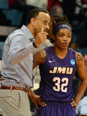 James Madison's Angela Mickens, a Robert E. Lee grad, and Dukes head coach Kenny Brooks talk over the action in 2015.
