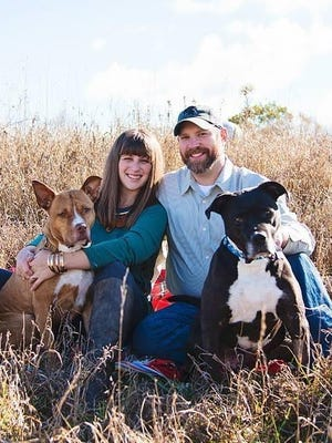 Rachel Peterson and her husband, Robby, with their rescue dogs Hector and Dikta at their home in Ionia.