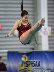 Canandaigua's Serica Hallstead performs a dive during
