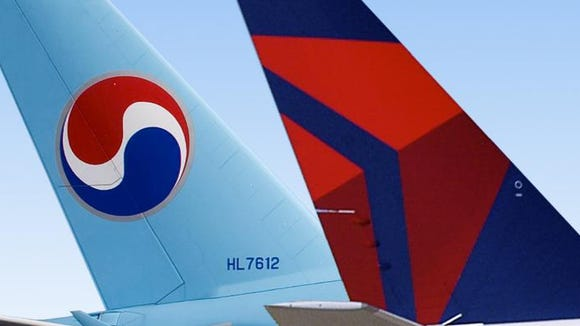 This image provided by Delta shows the tails of both