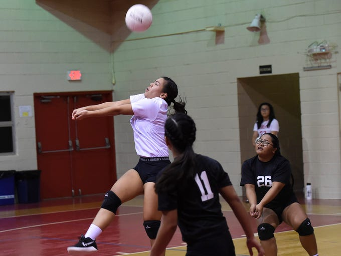 Tiyan High's BillieJean Taitingfong keeps the ball