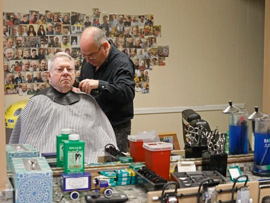 Mark Young of Eastchester, owner of the Buchanan Barber Shop in Buchanan cuts the hair of Steve Stein of Ossining on June 1, 2018.