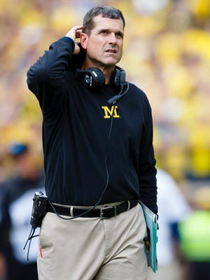 Michigan Wolverines coach Jim Harbaugh on the sideline in the fourth quarter against the UNLV Rebels at Michigan Stadium.