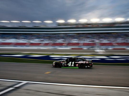 FILE - In this March 4, 2016, file photo taken with a slow shutter speed, Kurt Busch drives out of pit row during qualifying for a NASCAR Sprint Cup Series auto race in Las Vegas. Brothers Kurt and Kyle Busch grew up in Las Vegas and watched the construction of the local speedway, but Kyle has won at the track only twice and Kurt has never won. Both brothers would love to record a big win in their hometown, which is experiencing an explosion of growth in its professional sports scene. (AP Photo/John Locher, File)