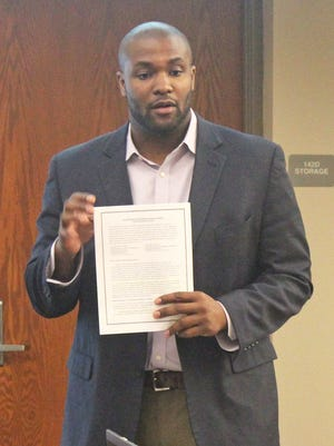 Kingsley Botchway, the Iowa City Community School District's equity and engagement director, presented a draft of a resolution supporting immigrant students to the school board on Feb. 28, 2017.