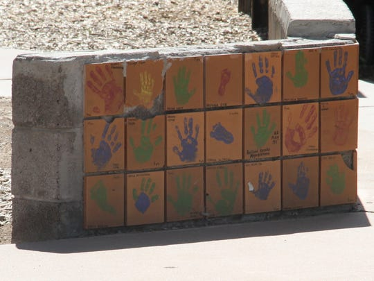 Alamogordo officials plan to leave in place the Kids Kingdom tiles that survived Friday's fire. The tiles were purchased to raise funds to build the original structure in 1995.