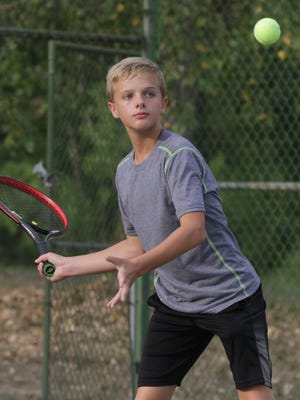 Tommy Secrist eyes a return en route to winning the boys 12 singles title Thursday in the 83rd News Journal/Richland Bank Tennis Tournament at Lakewood Racquet Club.
