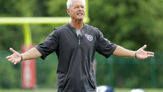 Tennessee Titans secondary coach Kerry Coombs cheers on his players as they stretch during NFL football minicamp Wednesday, June 13, 2018, in Nashville, Tenn. The Titans upgraded their secondary by signing cornerback Malcolm Butler, and safety Kevin Byard is coming off an All-Pro season. (AP Photo/Mark Humphrey)