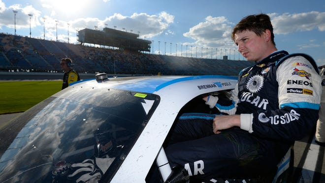 Brennan Poole climbs from his car after the NASCAR XFINITY Series race at Chicagoland Speedway on Sept. 17.