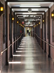 Hallways are long on the 175-acre campus Friday at