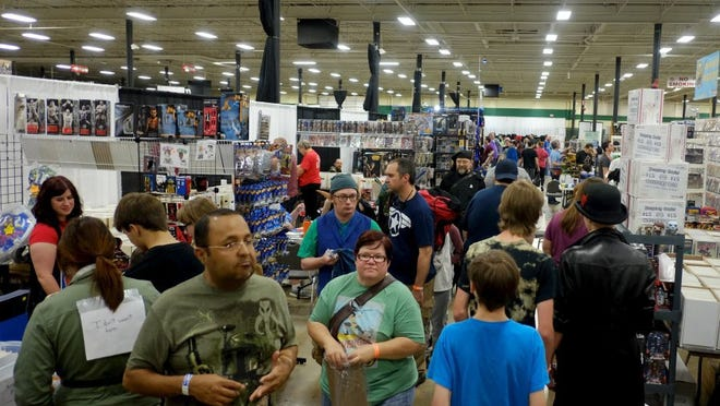 Comic fans fill the aisles during the Marble City Comicon at the Knoxville Expo Center on April 23, 2016.