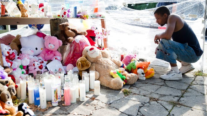 Richard Starchia pays respects July 28, 2014, at a makeshift memorial for three children who were killed Friday by a hijacked car that lost control and hit a group of people in Philadelphia.