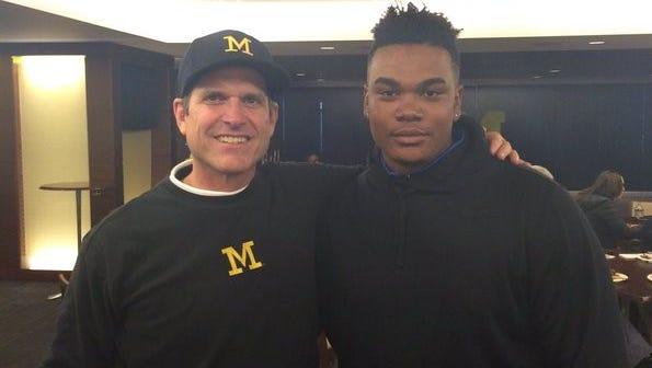 Michigan coach Jim Harbaugh and defensive tackle Jordan Elliott.