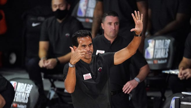Miami Heat head coach Erik Spoelstradirects his team during the first half in Game 6 of basketball's NBA Finals against the Los Angeles Lakers Sunday, Oct. 11, 2020, in Lake Buena Vista, Fla.