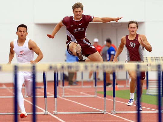 Calallen's Jackson Lanham and Flour Bluff's Kenneth Whitehurst compete in the boys 300 meter hurdles during the Region IV-5A Track and Field meet Saturday, April 29, 2017, at Alamo Stadium in San Antonio.