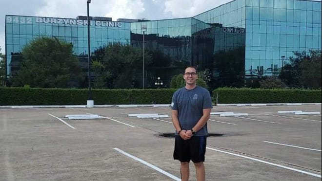 Michigan State Police Trooper Dane Van Ells poses for a photo outside of the Burzynski Clinic in Texas. Van Ells, of Pewamo, was diagnosed with a brain tumor in November 2019. A fundraiser to support Van Ells' medical costs is scheduled for Saturday, Aug. 29, at the Ionia Fairgrounds.