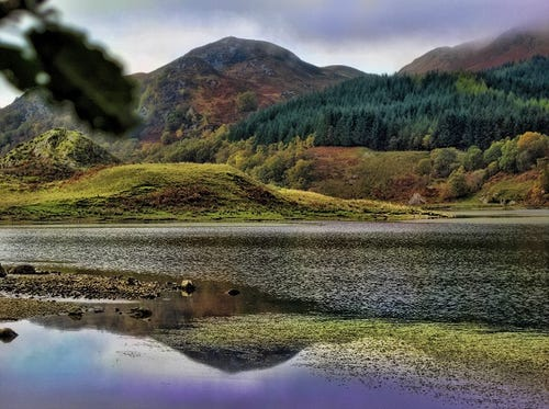 Hills Reflected in a Loch. (Photo: Tanya Anne Crosby)