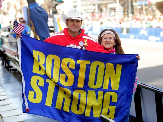 Carlos Arredondo and Melida Arredondo pose near the finish line during the 120th Boston Marathon on April 18, 2016.