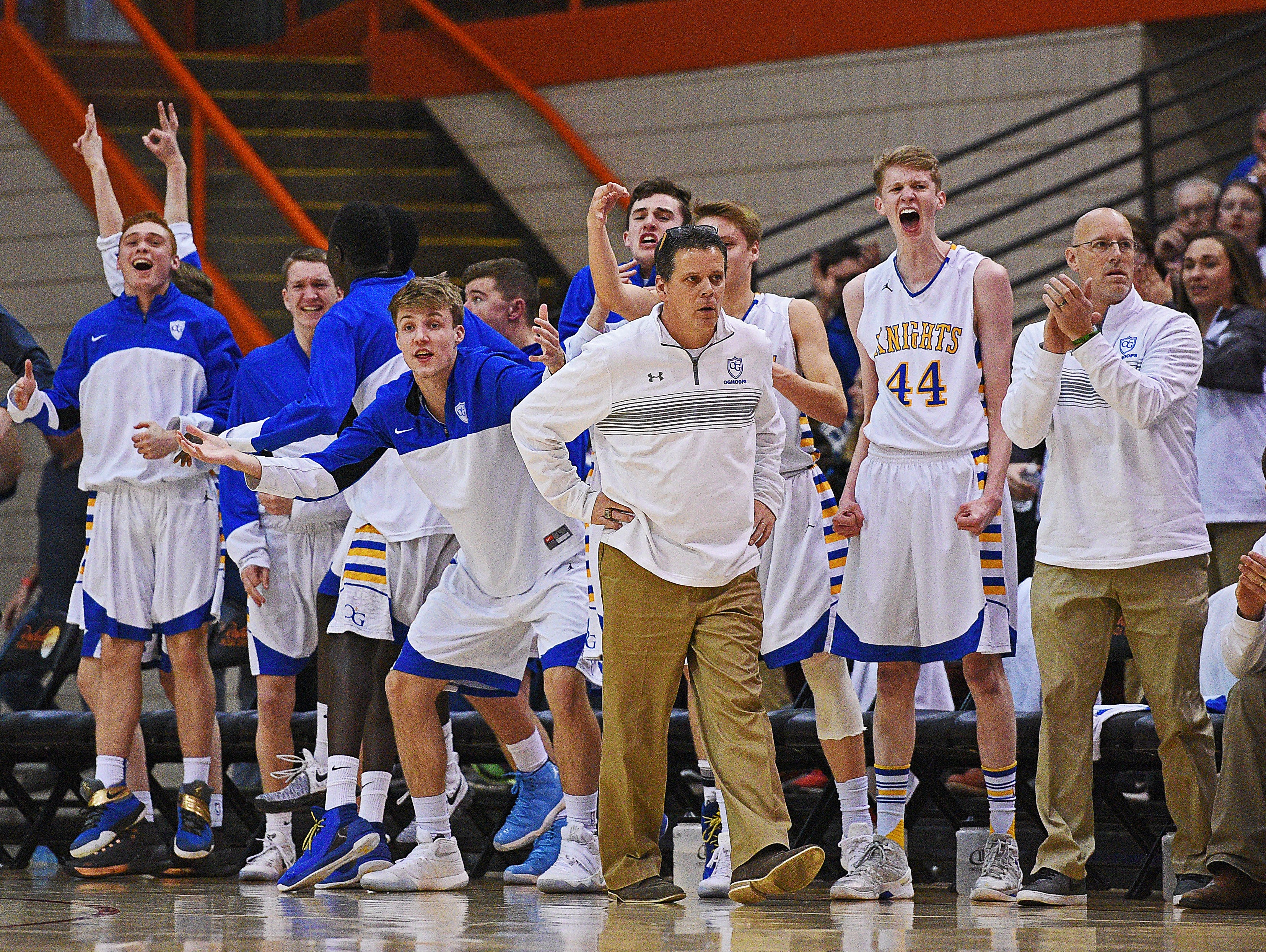 O'Gorman players react from the bench after a teammate scored during the 2017 SDHSAA Class AA State Boys Basketball championship game against Aberdeen Central Saturday, March 18, 2017, at Rushmore Plaza Civic Center in Rapid City.