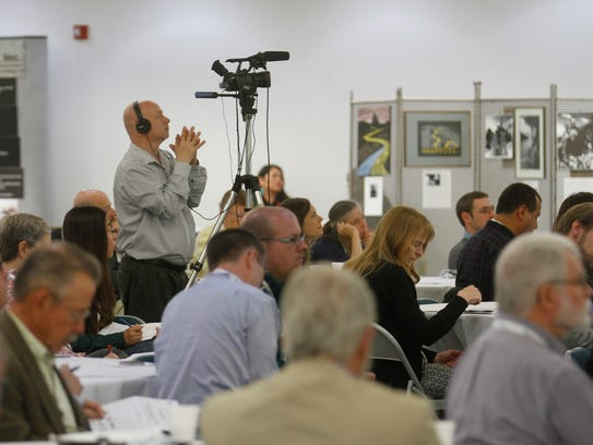 Participants at a conference on Environmental Conditions