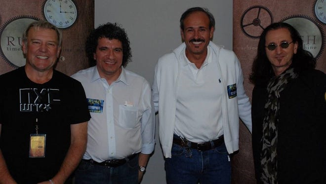 Left to right: Rush guitarist Alex Lifeson, Nashville Symphony music director Giancarlo Guerrero, his brother Fabio Guerrero and Rush lead singer Geddy Lee.