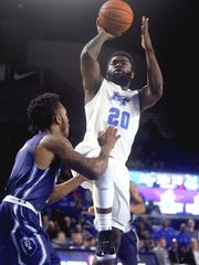 MTSU's Giddy Potts (20) goes up for a shot as Old Dominion's Ahmad Caver (4) guards him on Thursday, Feb. 9, 2017.