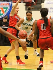 Ft. Myers Jarya Outten squeees through Ft. Walton defense