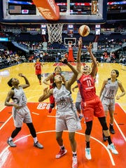 Washington's Elena Delle Donne puts up a shot over San Antonio's Kayla Alexander in the first half of the Washington Mystics' 89-74 win over the San Antonio Stars at the Verizon Center in Washington, D.C. on Sunday afternoon.