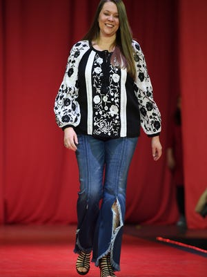 Amy Flippin walks the runway during the 2018 Go Red for Women Fashion Show at the Carl Perkins Civic Center.