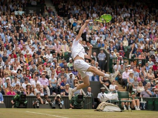 Sam Querrey soars to slam a return in his five-set