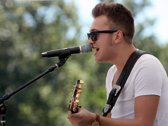 Seth Cook performs at Fam Fest at the Suzanne Gresham