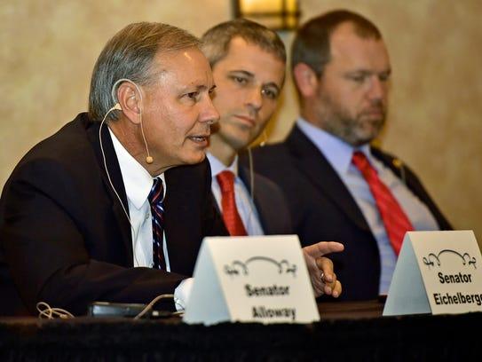 State Senator John Eichellberger, left, speaks during