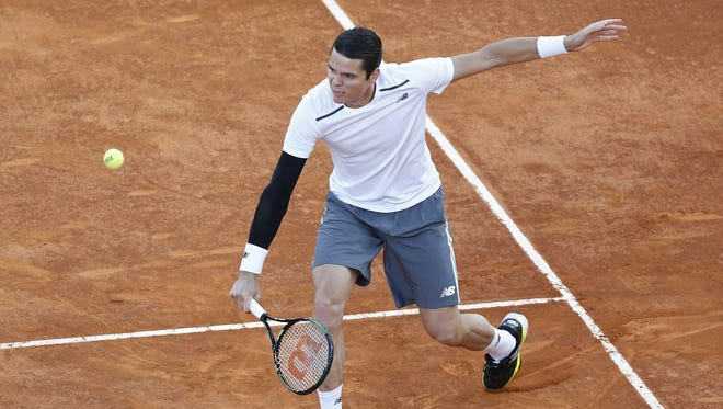 Milos Raonic had to withdraw from the French Open after surgery on a pinched nerve in his foot.