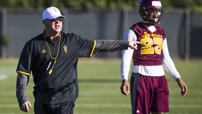 Offensive Coordinator Chip Lindsey barks orders at the Arizona State University football practice in Tempe, Monday, March 14, 2016.