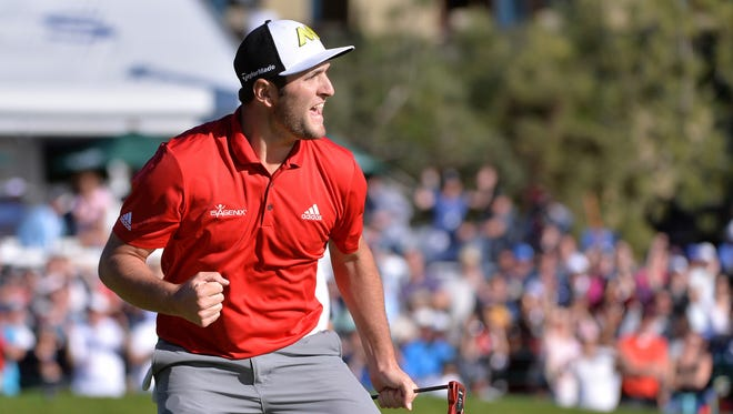 Jon Rahm celebrates after a eagle on the 18th hole during the final round of the Farmers Insurance Open golf tournament at Torrey Pines Municipal Golf Course on Jan. 29.