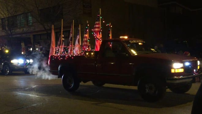 The Lafayette Truck Squad drives down Main Street during  Saturday's Lafayette Christmas Parade. Protesters greeted the club, which flies the Confederate flag, among other flags, during weekly parades through Greater Lafayette. The club did not fly the Confederate flag during the Christmas Parade, at organizers' insistence.