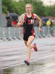 Rocori junior Madi Nilson runs her leg of the 1,600-meter