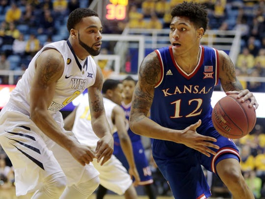 Kansas guard Kelly Oubre Jr. (12) looks to pass while