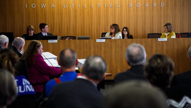 The Iowa Utilities Board discusses wether to allow Dakota Access to build the Bakken Pipeline through Iowa during a meeting in Des Moines on Thursday, Feb. 11, 2016.