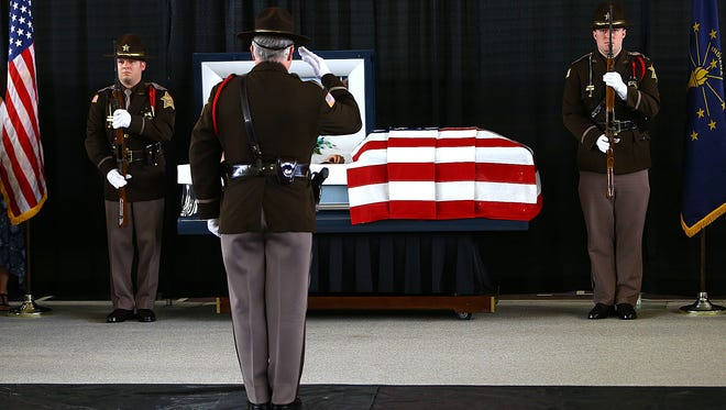Howard County Deputies Justin Markley and Jake Gibson stood watch over the casket of Deputy Carl Koontz on Monday, March 28, 2016, at Northwestern High School in Kokomo. Koontz was killed in the line of duty March 20 in Russiaville. Koontz and Gibson worked together at the high school as resource officers.