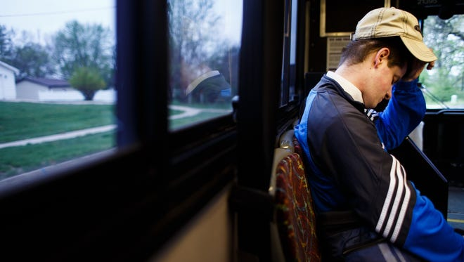 Tyler Crawford, 22, of Windsor Heights, rides the DART bus from 73rd Street to Valley West Mall and then walks to work at the Fareway in Clive. Valley West Mall is forcing DART to remove its bus stop, which will force Crawford, who is legally blind and can't drive, to quit his job.